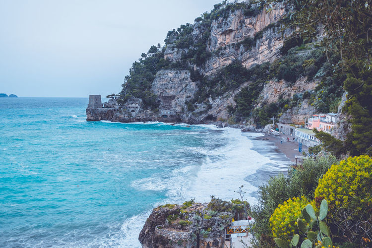 The hidden beach of Amalfi coast, Italy Sea Water Beauty In Nature Scenics - Nature Rock Land Nature Day Rock - Object Solid Sky Rock Formation Beach Cliff No People Tranquil Scene Motion Outdoors Architecture Horizon Over Water Formation Turquoise Colored Rocky Coastline Positano Italy Europe Amalfi Coast Cliffs Blue Water Wave Amazing View