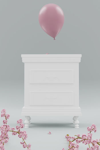 classic white bedside table with pink balloon behind cherry blossom branches Balloon Pink Color Classic Bedside Table Furniture Spring Beginning Of Spring Plant Cherry Blossom Springtime Soft Rise Minimalism Minimal Drawer Cupboard Season  Seasonal Old Vintage Decoration Decor Indoors  Table Still Life Flower Blossom Fragility Nature Style Japanese Cherry Blossoms Japanese Cherry Studio Shot Elegance Beauty Pink White White Color
