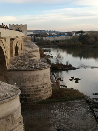 Roma Cordoba Spain Puente Romano De Cordoba Atardecer Al Caer La Tarde Córdoba Redefining Menswear Water Sunset Business Finance And Industry Sky Landscape Archaeology Ancient Ancient Civilization Old Ruin Ancient History The Past Ancient Rome Civilization Horizon Over Water Water Wheel
