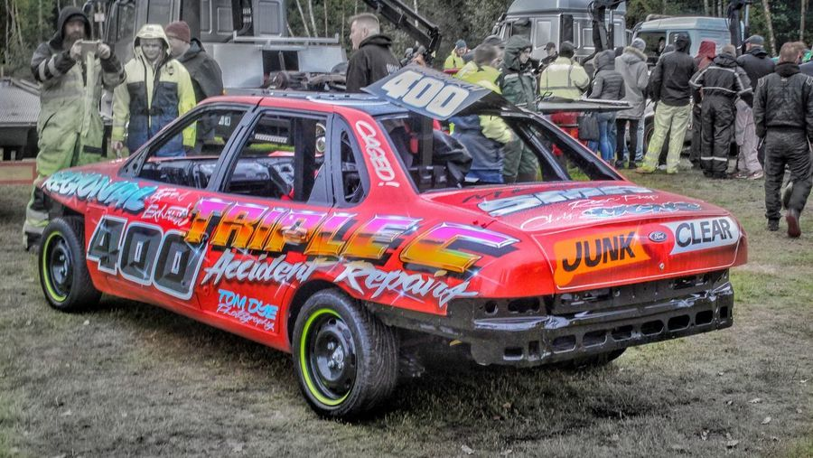 Banger Racing Mode Of Transportation Transportation Land Vehicle Motor Vehicle Car City Architecture Street Red Day Built Structure Accidents And Disasters Text Incidental People Outdoors Fire Engine Stationary Police Car Western Script Road