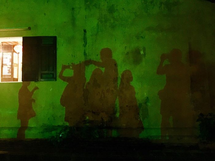 Hoi An, in the shadow of the Japanese Bridge Real People Shadow Shadows & Lights People Taking Pictures World Heritage Site By UNESCO Hoi An, Vietnam Green Color Night Photography Nightphotography