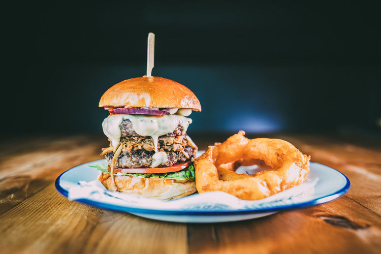 American Food Bun Burger Burger Burgers Close-up Day Fast Food Focus On Foreground Food Food And Drink Freshness Hamburger Indoors  Indulgence No People Plate Ready-to-eat Sandwich Sweet Food Table Unhealthy Eating