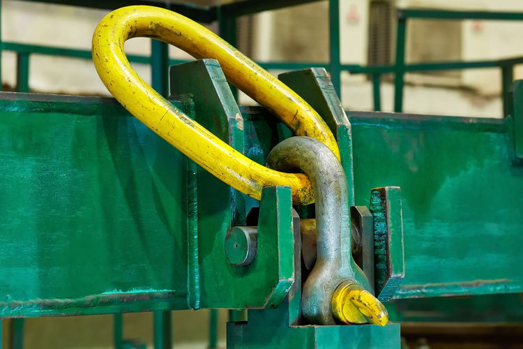 Close-up of yellow machine part