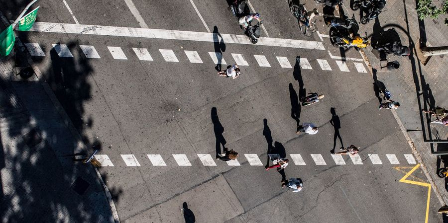 Group Of People City Real People Sign Street Road Marking Crowd Marking High Angle View Zebra Crossing Large Group Of People Crossing Road Sunlight Transportation Symbol Shadow Walking Crosswalk Day