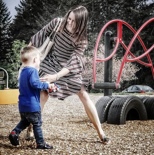 Mother and Son Darryn Doyle Check This Out Mother And Son Motherhood Toddlerlife Toddler Boy Growing Up Child Spraying Childhood Males  Full Length Boys Standing Car Casual Clothing Slide - Play Equipment Outdoor Play Equipment Playground Friend Only Boys