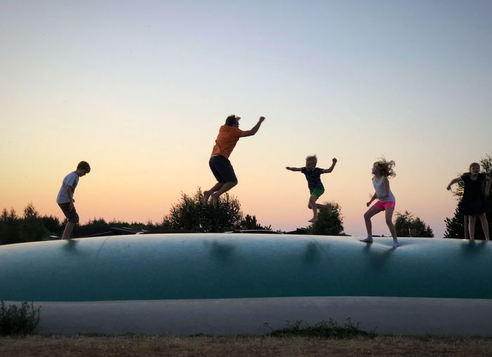 Outdoor Playing Family Jumping Sunset Trampolin  Jump Sky Clear Sky Real People Leisure Activity Group Of People Nature Lifestyles Fun People My Best Photo