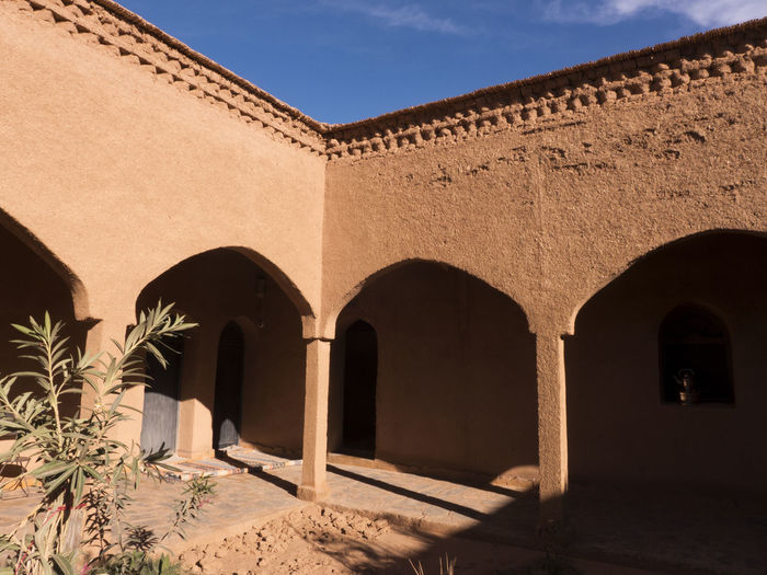 Courtyard of a Moroccan house. The house is built of mud bricks. Architecture Arch Built Structure Nature Building Exterior History Ancient The Past Sky Building Shadow Architectural Column Outdoors Plant Sunlight Travel Destinations Courtyard  Archaeology Morocco Mud Mud Bricks Africa Desert Arabic