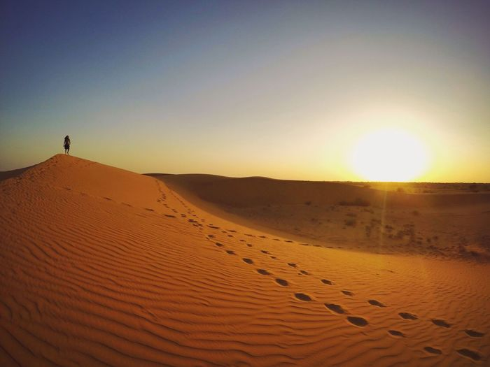India, Rajasthan, Jaisalmer Sand Desert Sand Dune Sunset Nature Beauty In Nature Arid Climate Tranquility Sky Tranquil Scene Landscape Clear Sky Scenics Outdoors Real People Extreme Terrain Sun Heat - Temperature Day India Rajasthan Jaisalmer Desert Thar Desert Hazy