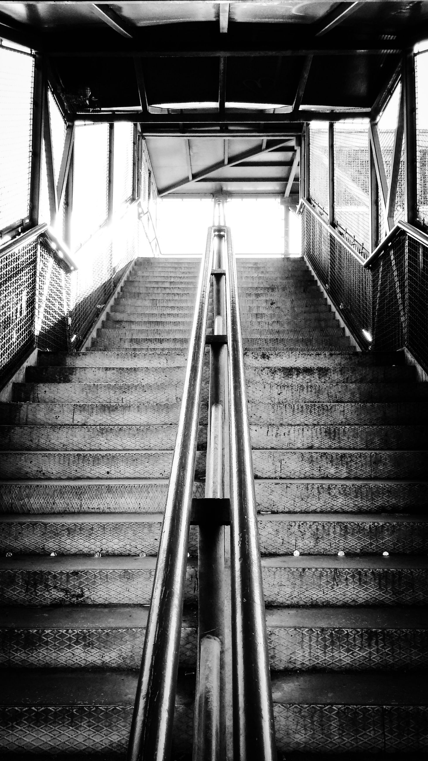 steps and staircases, steps, staircase, railing, low angle view, escalator, indoors, built structure, architecture, the way forward, metal, stairs, transportation, diminishing perspective, high angle view, steps and staircase, sunlight, day, no people, roof