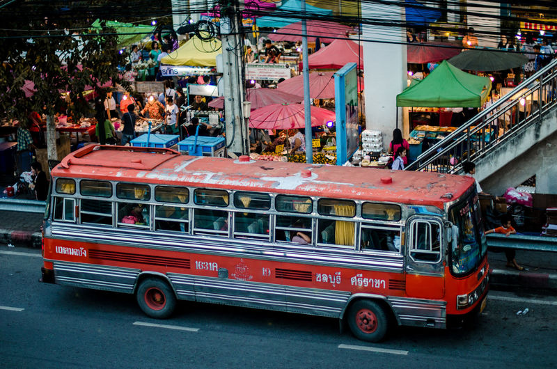 Vintage local bus in Thailand Bus Chon Buri City Life Local Bus Market Market Stall Old Omnibus Retail  Road Street Photography Text Thailand Transport Transportation Transportation Trip Vintage