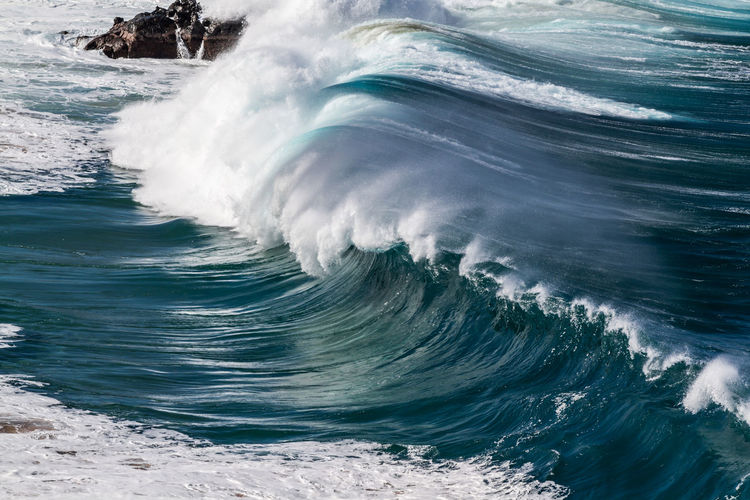 A giant Ocean wave at Waimea Bay on the north shore of Oahu Hawaii Big Waves Giant Hawaii Oahu Surf Travel Beauty In Nature Blue Crashing Waves  High Angle View Landscape Motion Nature No People North Shore Ocean Outdoors Rocks Sea Seascape Travel Destinations Waimea Bay Water Wave Waves