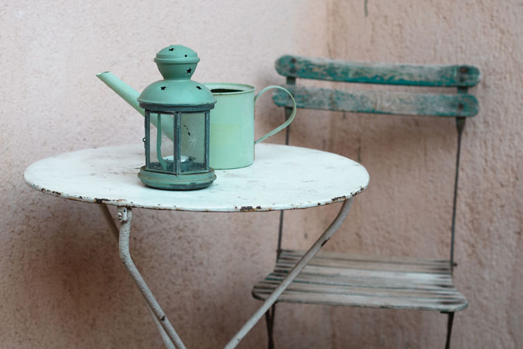 Outdoor vintage furniture Composition Lantern Metal Table My Travel Photography Patio Provence Round Table Tourist Attraction  Travel Close-up Contrast Day Green Lantern  Indoors  Lantern On A Table Metal No People Old Chair Old Furniture Simple Small Furniture South Of France Table Vintage Green Wood - Material