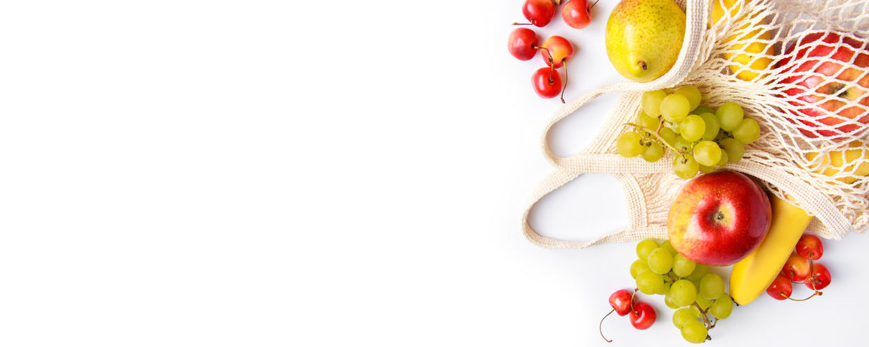 High angle view of fruits over white background