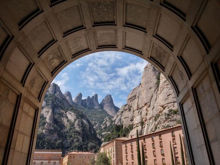 Monastery buildings against mountain rocks