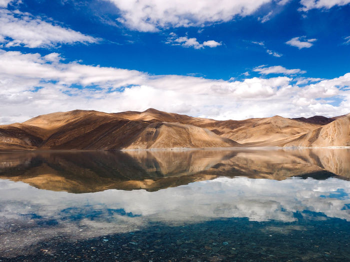 :> Cloud - Sky Sky Scenics - Nature Water Beauty In Nature Environment Mountain Nature Lake Tranquility Day Landscape No People Outdoors Mountain Range Travel Destinations Arid Climate Land Blue Reflection Mountain Peak Travel India LoveNature EyeEmNewHere
