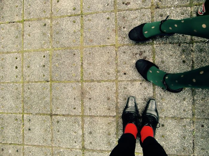 Concrete Day Fashion Feet Girlfriends Girls Green Green Socks Green Stockings Legs Leisure Activity Outdoors Outside Personal Perspective Real People Red Red Red Socks Red Stockings Shoe Shoe Shoes Socks Stockings Women