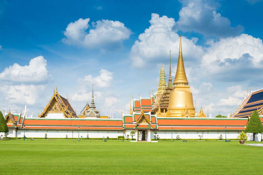 Wat phra keaw or Emerald Buddha temple in Bangkok,Thailand. Ancient Architecture Bangkok Cityscape Emerald Buddha Temple Famous Thailand Tradition Travel Architecture Buddhism Built Structure Capital Day Grass Landscape Nature Outdoors Palace Place Of Worship Religion Sky Spirituality Temple Travel Destinations