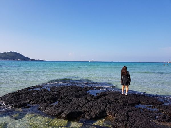 Shegazedoutintotheseaquietly Looking At The Sea Mood Ocean Jeju Korea Me Beach Beauty In Nature Clear Sky Looking At View Nature One Person Real People Rear View Rock Scenics - Nature Sea Sky Standing Water The Great Outdoors - 2018 EyeEm Awards