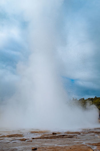 Iceland Beauty In Nature Cloud - Sky Day Erupting Geyser Heat - Temperature Hot Spring Motion Nature No People Outdoors Power In Nature Scenics Sky Spraying Steam Travel Destinations Water