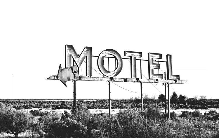 No People Motel Sign Motels Text Signage Symbol Old Sign Sleepy Motel Hotel Accomodation Accomodations Arrow Arrow Symbol Inn Bed And Breakfast Place To Rest Place To Stay Deserted Black And White Pointing Copy Space Backgrounds Motelsigns Motel Signs Black And White Friday An Eye For Travel