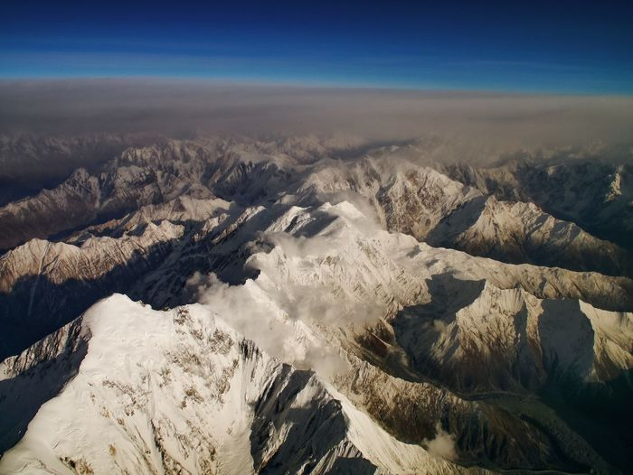 Aerial view of the himalayas against sky