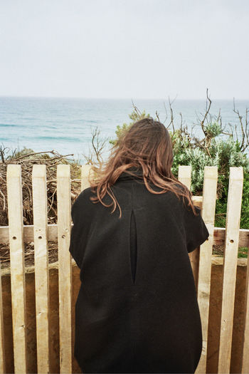 A woman looks out over the ocean in Victoria, Australia. Taken on 35mm film. Nature Nature_collection Nature Photography Naturelovers Nature On Your Doorstep Woman Ocean Ocean View Sea Seascape Sea And Sky Day Outdoors Lifestyles Scenics Scenics - Nature Copy Space Copy Space In Sky