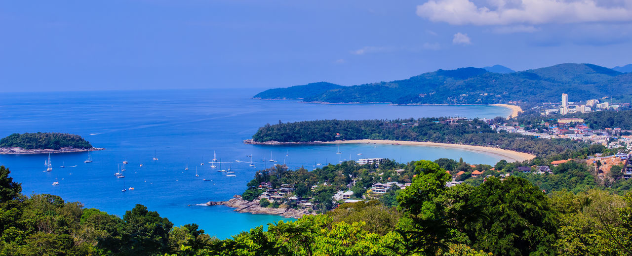 Beautiful seascape of turquoise ocean waves with boats, coastline and blue sky background from high aerial view point of Kata and Karon beaches in Phuket Thailand. Aerial View Of Beach Coastline Coastline Landscape Karon Beach, Phuket Karon Beach, Phuket, Thailand Kata Beach Kata Beach,Phuket Thailand Kata Beach Phuket, Thai Seascape Photography Aerial View Aerial View Of City Architecture Beauty In Nature Blue Building Exterior Built Structure City Cityscape Coastal Coastal Landscape Coastline Beauty Coastline Sky Day High Angle View Horizon Over Water Karon Beach Karon View Point Karon Viewpoint Kata Kata Noi Beach Mountain Nature Nautical Vessel No People Outdoors Scenics Sea Seascape Seascape Skyscape Sky Tranquility Transportation Tree Turquoise Turquoise Sea Water