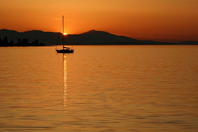 Vancouver Island Sunset Sailboat In Sunset Sailboat Mast Sunset Silhouettes Beauty In Nature Orange Color No People Water Oceansunset Ocean Tranquility Reflection Moored TheWeekOnEyeEM