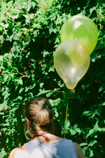 Rear view of woman with balloons