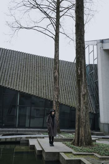Traveling In China Silence Standing One Person Architecture Built Structure Building Exterior Tree Plant Nature Building