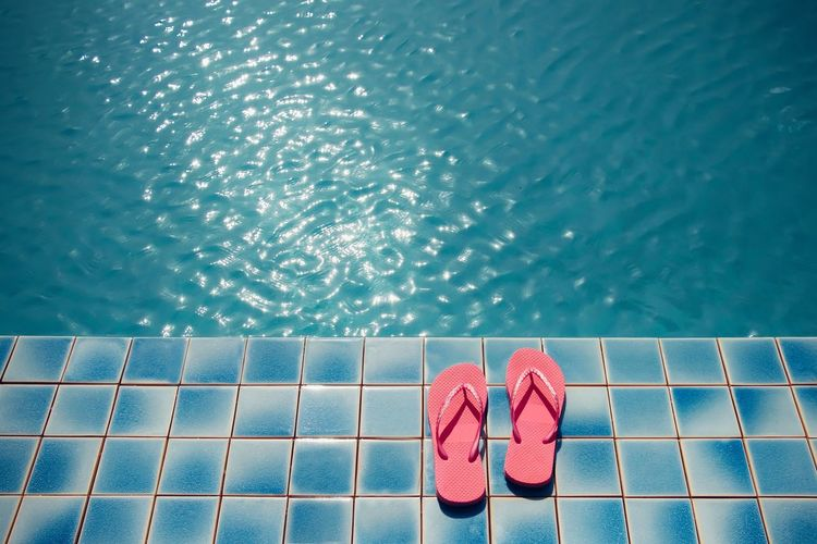 Pink sandals at pool side for summer concept Water Swimming Pool Pool Poolside Nature Flooring Slipper  Blue Human Foot Shoe Pink Color Summer Sandal