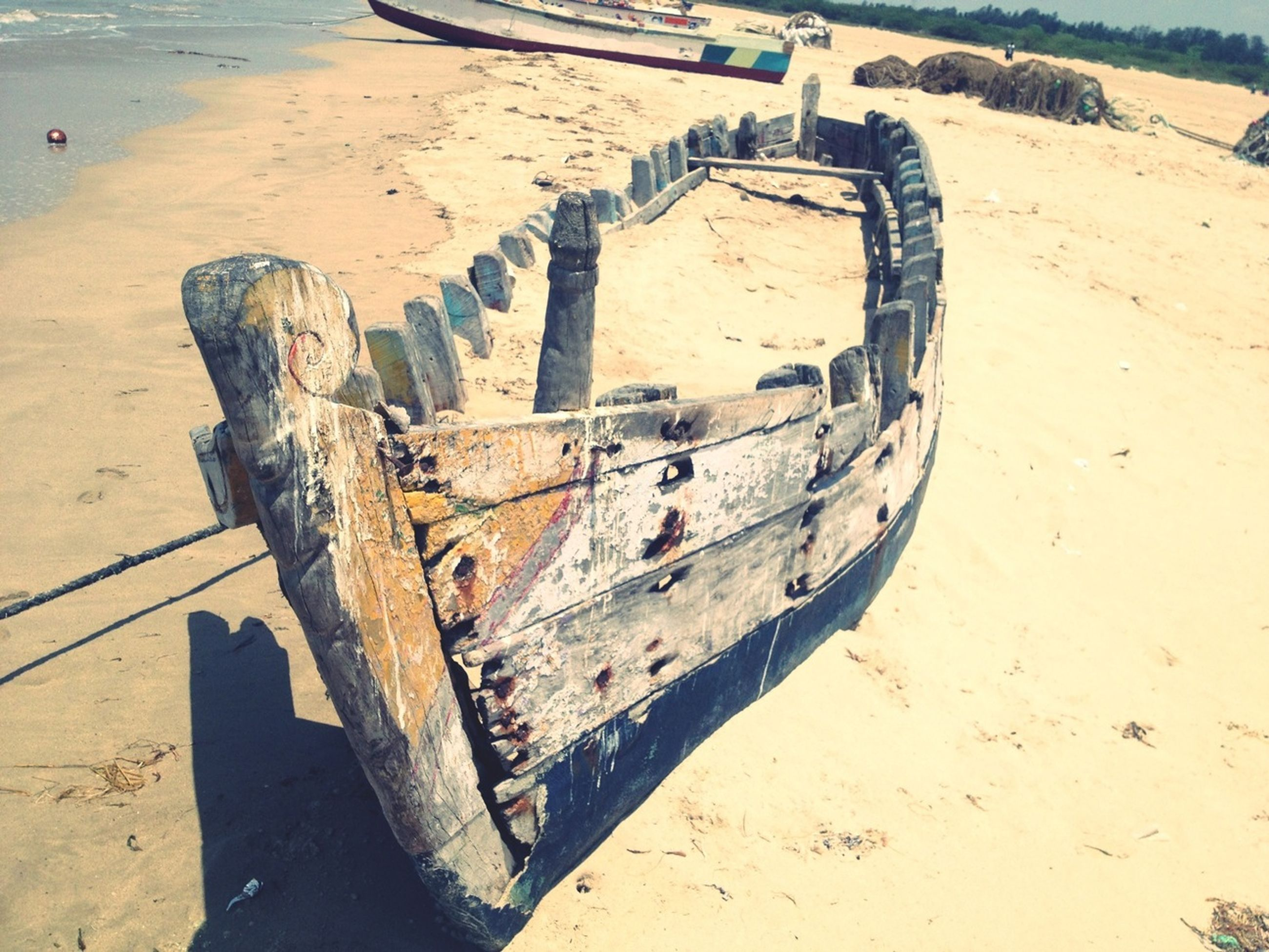 sand, beach, transportation, mode of transport, water, shore, abandoned, nautical vessel, sea, boat, obsolete, sunlight, damaged, tire, moored, wheel, travel, old, day, land vehicle