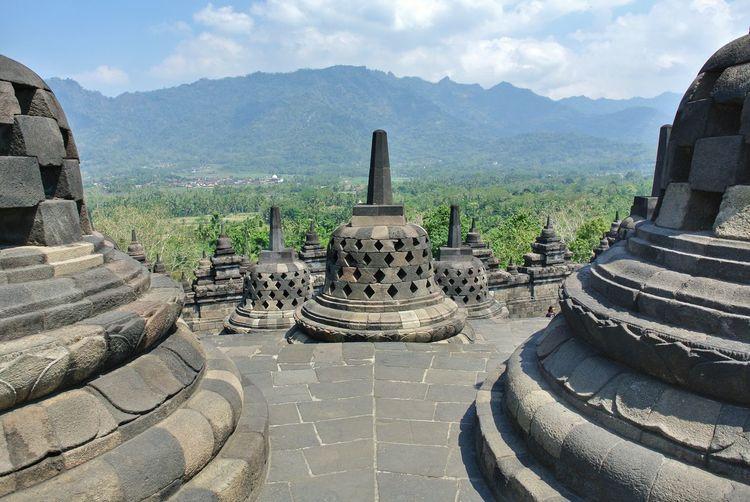 Ancient temple against mountain range