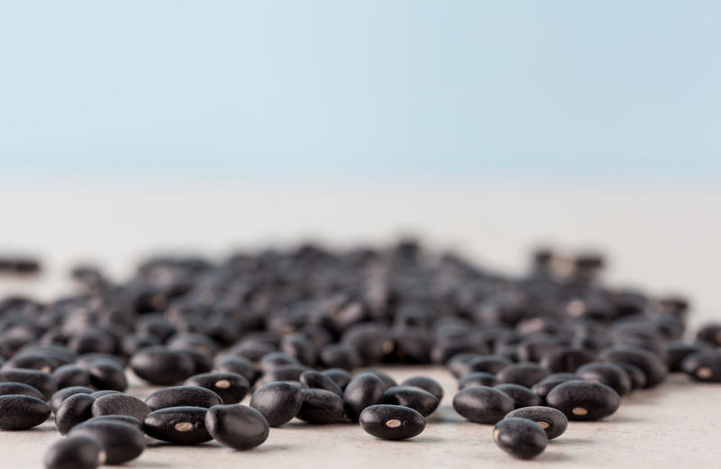 Black turtle beans on bright surface with copy space. Shallow depth of field. Beans Abundance Close-up Day Focus On Foreground Food Food And Drink Freshness Healthy Eating Nature No People Outdoors Selective Focus Table Turtle Beans