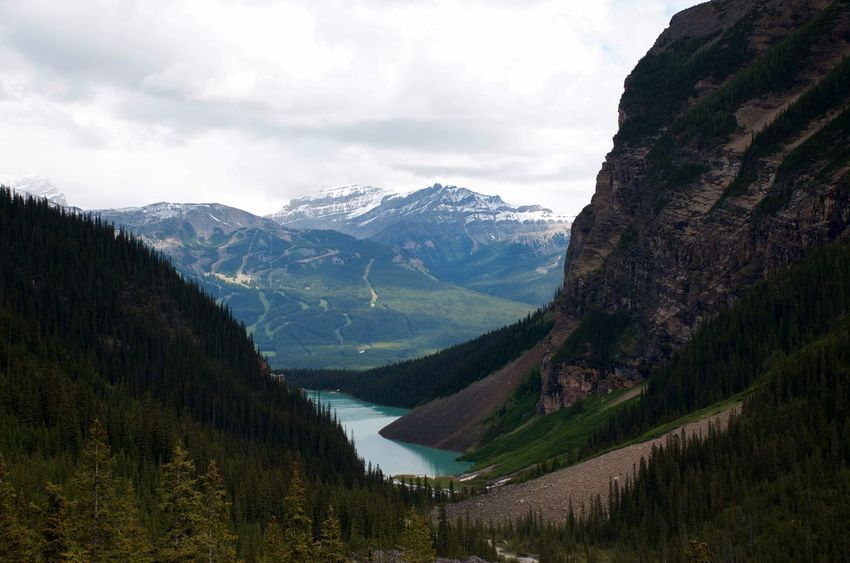 Amazing View Banff National Park  Breathtaking View Hiking Lake At The Foot Of A Mountain Travel Blue Green Water Clouds And Sky Destination Glacial Lake Lake Louise  Landscape Mountain Mountain Range No People