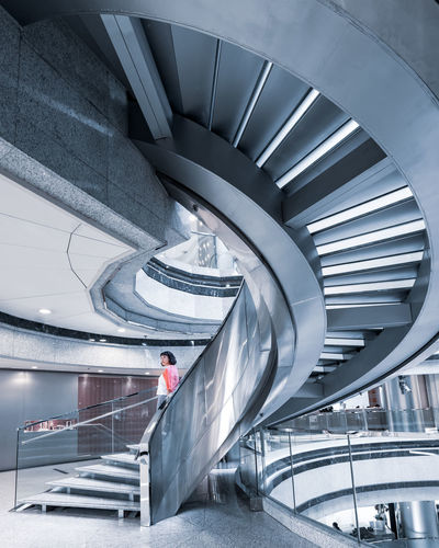 The Minimalist - 2019 EyeEm Awards Ceiling Building Lifestyles Men High Angle View Adult Escalator Women Illuminated One Person Real People Spiral Modern Indoors  Built Structure Railing Steps And Staircases Staircase Architecture Minimal People Interior Design Hong Kong Architecture Cool Attitude 螺旋階段 Spiral Staircase EyeEm Best Shots EyeEm Selects EyeEm Gallery Indoors