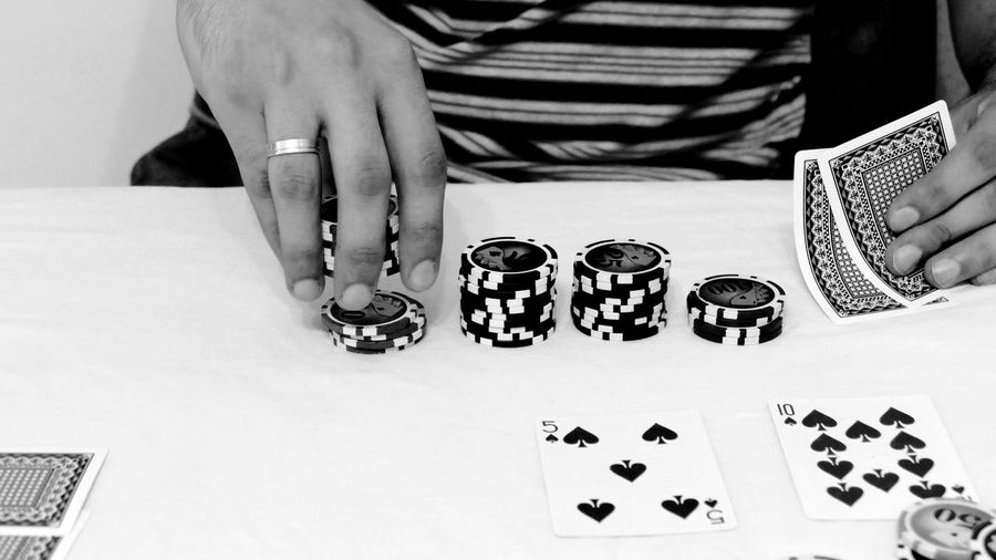 Cards Chance Close-up Day Dice Gambling Gambling Chip Human Body Part Human Hand Indoors  Leisure Activity Leisure Games Lifestyles Luck Midsection One Person People Playing Poker Poker - Card Game Poker Game Real People Sitting Table
