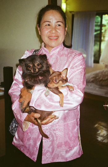 keeper 35mm Film Analogue Photography Asian Woman Chiang Rai, Thailand Traditional Clothing Adult Animal Themes Dog Domestic Animals Film Photography Home Interior Indoors  Lifestyles Looking At Camera Mammal Mature Adult Mature Women Togetherness Hug One Person People Pets Portrait Real People Smiling