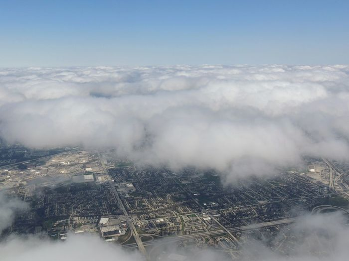 Aerial view landscape and cityscape of Indianapolis through clouds. View from airplane. Indianapolis is the capital and most populous city of the U.S. state of Indiana and the seat of Marion County Agriculture Architecture Area City Cityscape Cloud Field Top Travel Aerial Aerial View Air Airplane Architecture Background Building Flight High Angle View Landscape Nature Neighborhoods Outdoors River Sky Top View