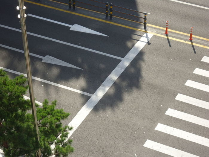 Asphalt Cordon Tape Crossing Day Dividing Line No People Outdoors Road Road Marking Road Sign Street Traffic Cone Transportation Urban White Line
