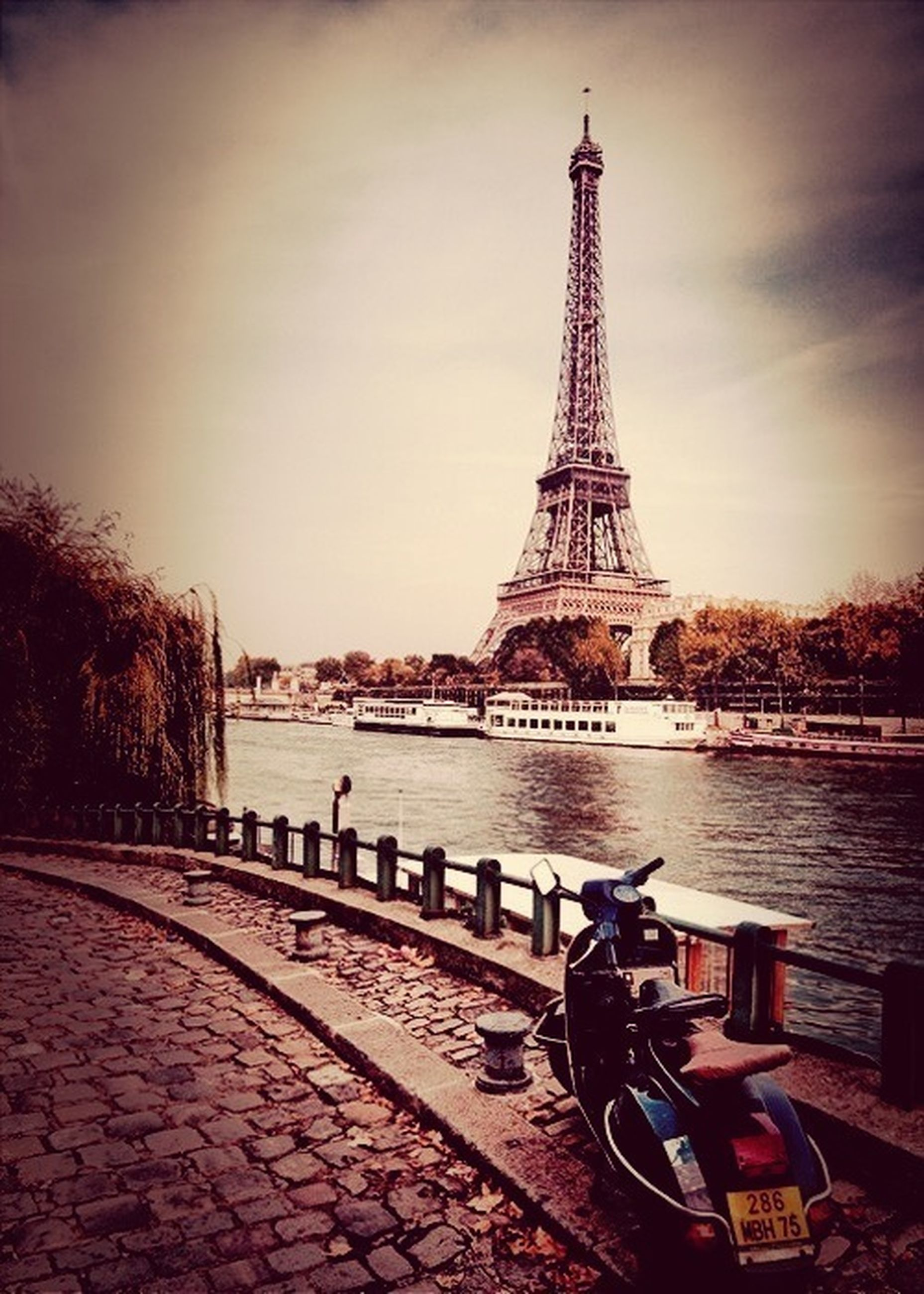 eiffel tower, built structure, architecture, famous place, travel destinations, sky, culture, international landmark, tower, tourism, travel, building exterior, metal, capital cities, water, transportation, river, city, tall - high, history