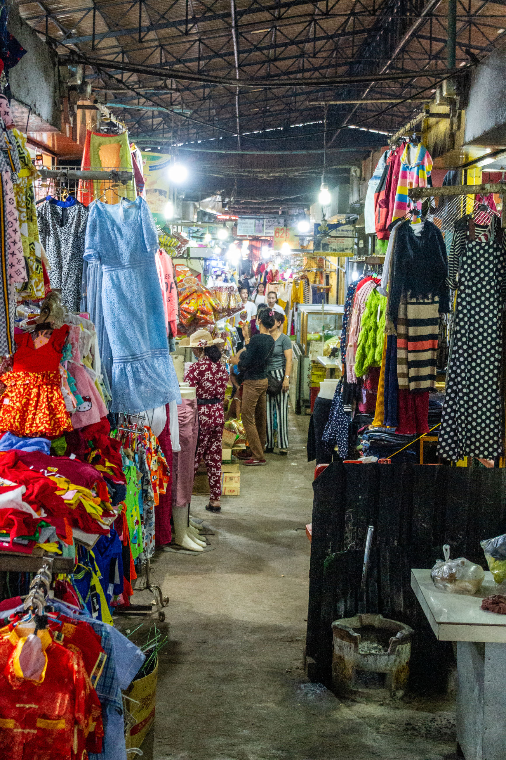 market, retail, choice, market stall, for sale, variation, small business, business, real people, abundance, shopping, large group of objects, hanging, incidental people, women, street market, buying, store, illuminated, multi colored, sale, consumerism, retail display