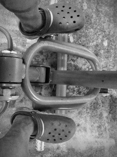 Low Tech Exercising Black & White Exercise Exercising Looking Down Mechanic Sandals Slippers Black And White Collection  Blackandwhite Photography Bw_collection Close-up Croc Day Feet Feetselfie High Angle View IPhone Photography Low Tech Monotone My Feet No People Outdoors Pedal Shoes Vehicle Part