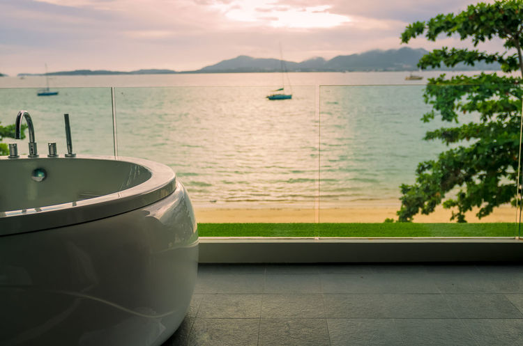Outdoor jacuzzi Cloudy Sky Phuket Terrace Thailand Vacations Balcony Beach Beauty In Nature Horizon Over Water Jacuzzi  Nature Nautical Vessel No People Outdoors Scenics Sea Seaview Sky Sunset Tranquility Tree Water