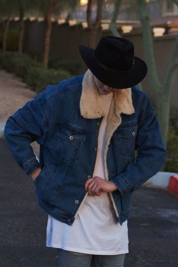 Cowboy calling Denim Western Fashion Style Cowboy Hat Clothing Casual Clothing Real People One Person Three Quarter Length Leisure Activity Men Adult Lifestyles Street Day Jeans