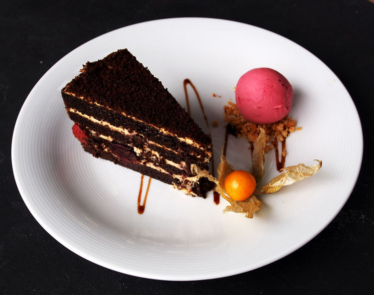 piece of chocolate cake with a ball of crimson ice cream Ice Tart Ball Black Background Browny Cake Close-up Cream Crimson Day Dessert Food Food And Drink Freshness Healthy Eating High Angle View Indoors  No People Piece Plate Ready-to-eat Sweet Food Yummy