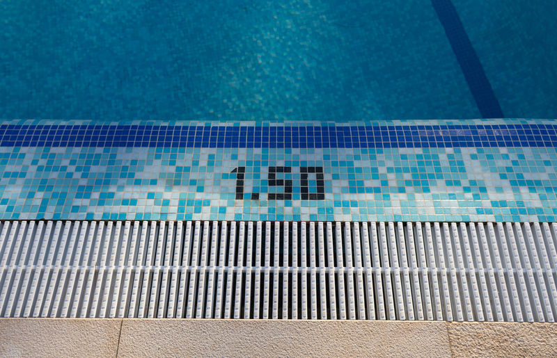 High angle view of numbers on poolside at swimming pool