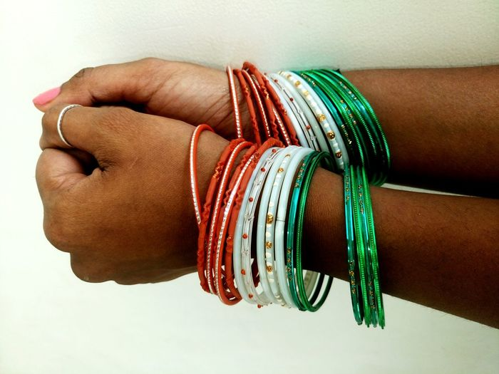 Human Hand Jewelry Human Body Part Adults Only Men People Ring Adult Celebration One Person Life Events Women Indoors  Ceremony Close-up Bangle Day Green Color Orange Color White Color Indian Flag Independence Day Republic Day Republic Day 26 January Indian Culture