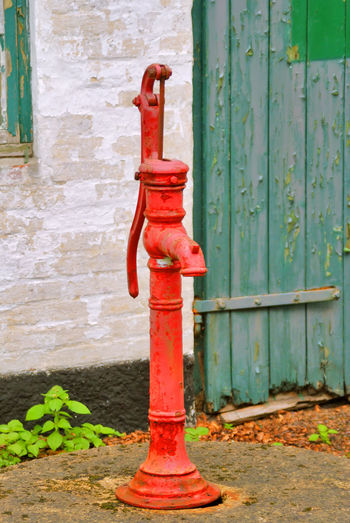 An old red water pump Flowing Water Late Middle Ages Objects Pump Retro Water System Architecture Building Exterior Close-up Day Fire Hydrant Groundwater No People Object Object Photography Old Outdoors Red Red Pump Retro Style Retro Styled Running Water Water Pump Water-tap Weathered