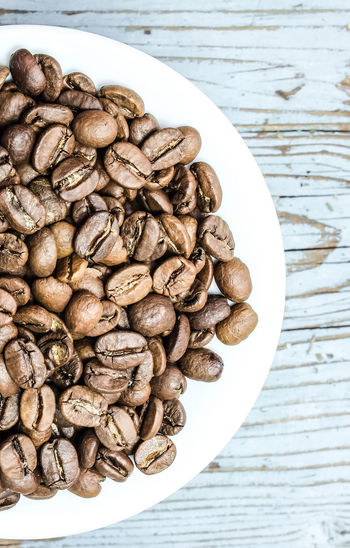 Coffee, background, raw coffee beans Brown Close-up Coffe Beans Coffee Bean Coffee Time Day Food Food And Drink Freshness Healthy Eating Indoors  Large Group Of Objects No People Nut - Food Raw Coffee Bean Still Life Table